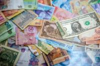 Pile of money in different foreign currencies