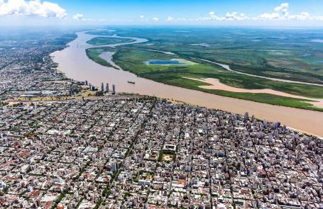 Birds-eye-view of Rosario, Argntina. A river divides urban and rural landscapes.