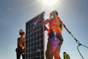 Clemson University team members install solar panels during the U.S. Department of Energy Solar Decathlon
