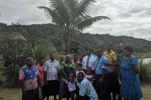 Fiji's Attorney General Aiyaz Sayed-Khaiyum (center, white shirt and tie) with the villagers from Navaceitavou