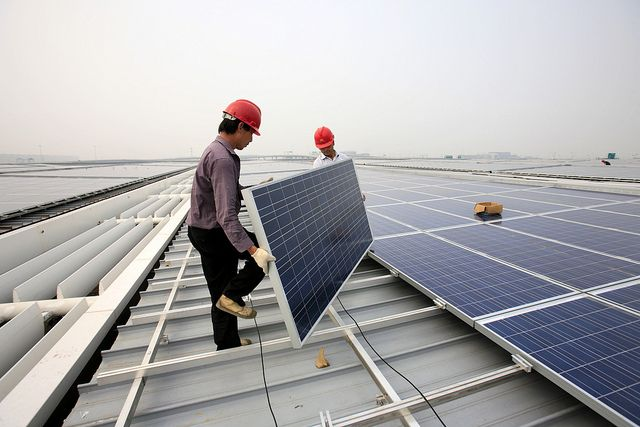 Men installing solar panels in Shanghai