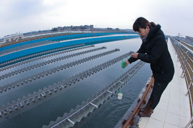 A woman tests the water quality at a plant in Jiangxi Province, China. Flickr/Asian Development Bank