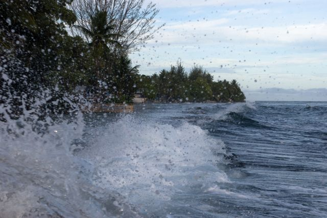 Waves crash on an atoll in the Marshall Islands. Flickr/Elizabeth Kate Switaj