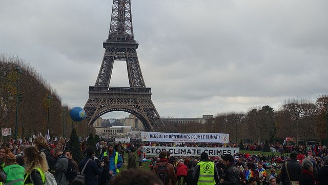 Crowd by the Eiffel Tower in Paris during COP21