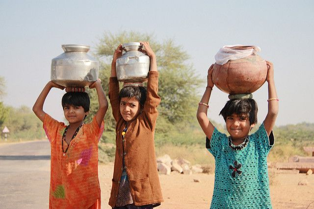 Children in India carry water.