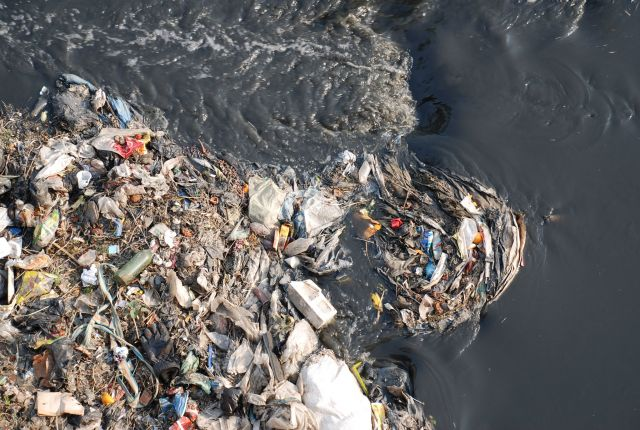 Polluted waterways carry impacts of poor sanitation citywide. Photo by SusanA Secretariat/Flickr