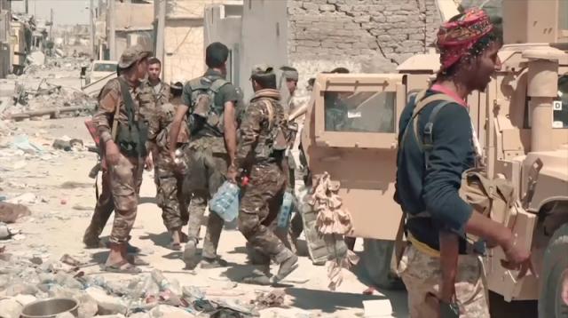 SDF fighters in central Raqqa