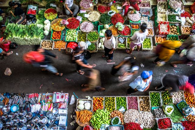 Aerial view of people and goods in a busy Jakarta street market. Photo by Henry Sudarman/Flickr.