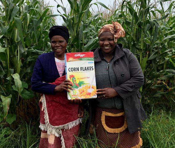 Women holding Kellogg's Cornflakes box