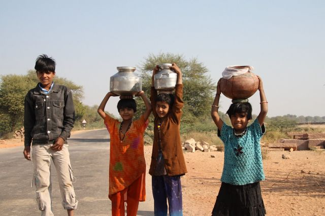 Kids carrying water in the Indian countryside. Photo by Mr. Fink/Flickr