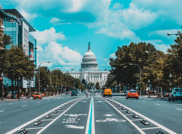 A city street in Washington, D.C. that ends at the Capitol building.