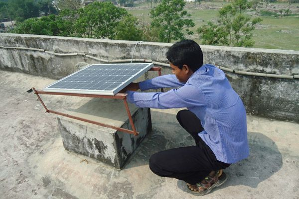 Solar home systems in Bangladesh. Photo by ILO/Flickr.