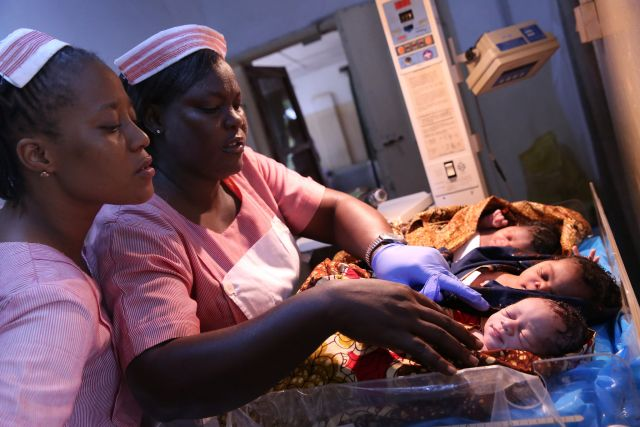 Nurses care for newborns at a maternity hospital in Sierra Leone. Photo by Dominic Chavez/World Bank.