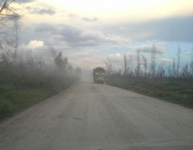 dusty road to Sungai Berbari village