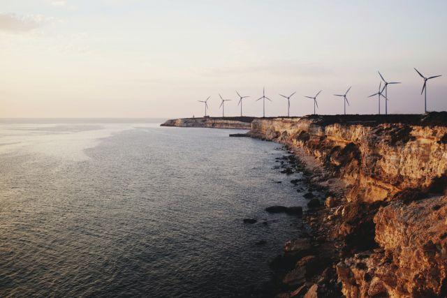 Windmills along a shoreline