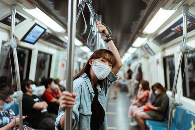 Woman in face mask on subway