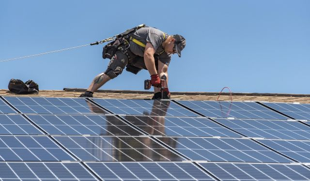 Man installing panels