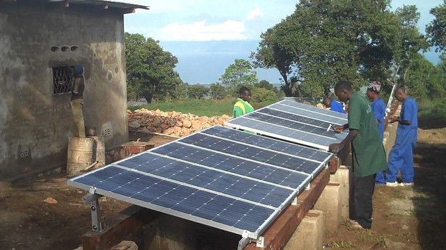 Installing solar panels in Burundi. Photo by Solar Electric Light Fund/Flickr