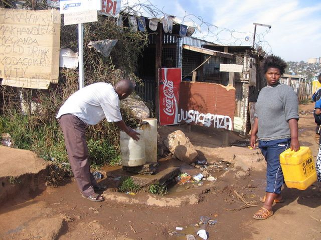 A communal water tap in Soweto, South Africa. Photo credit: E. Muench, Wikimedia Commons