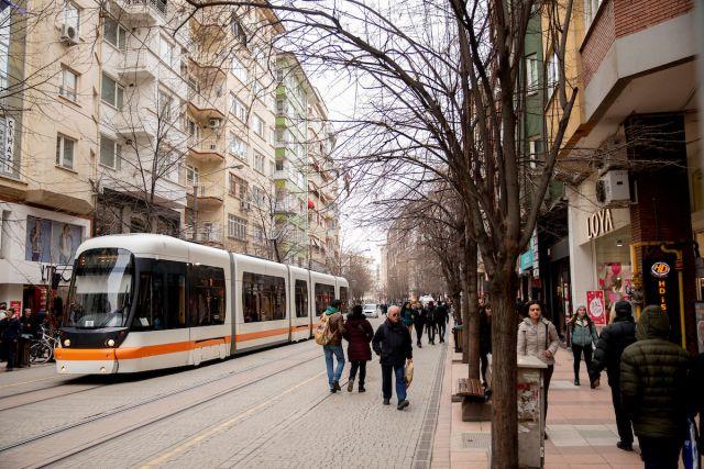 Electric tram and pedestrians on a street in Eskişehir, Turkey