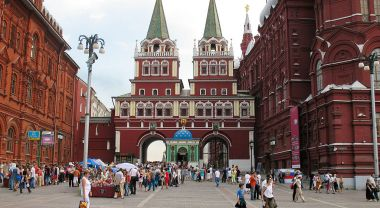 People walking by the entrance of Moscow's Red Square