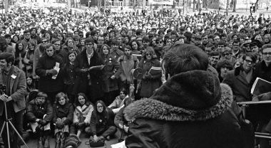 Black and white photo of a crowd and speaker outside the University of Michigan for the first Earth Day in 1970.
