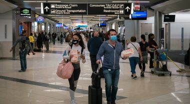 Travelers at Hartsfield-Jackson Atlanta International Airport, March 6, 2020