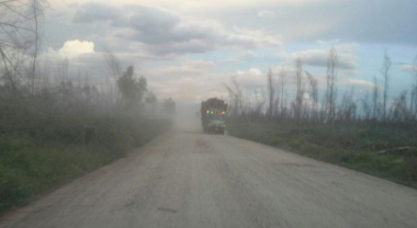 dusty road to Sungai Berbari village