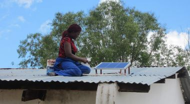 Installing a rooftop solar panel in Malawi