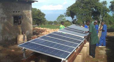 Installing solar panels in Burundi. Photo by Solar Electric Light Fund/Flickr