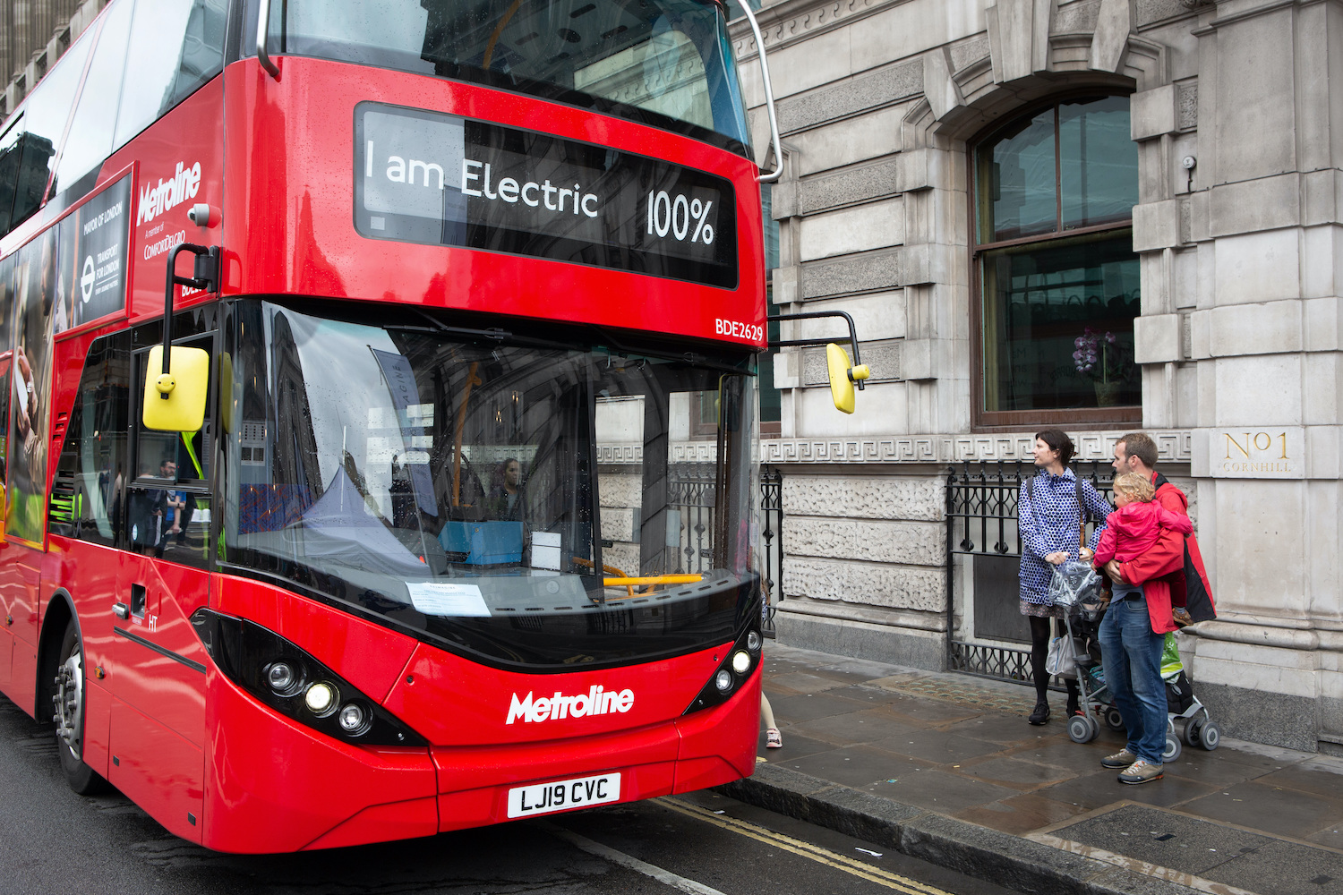<p>A family boards an electric bus in London\'s new Ultra Low Emission Zone. Photo by Greater London Authority</p>