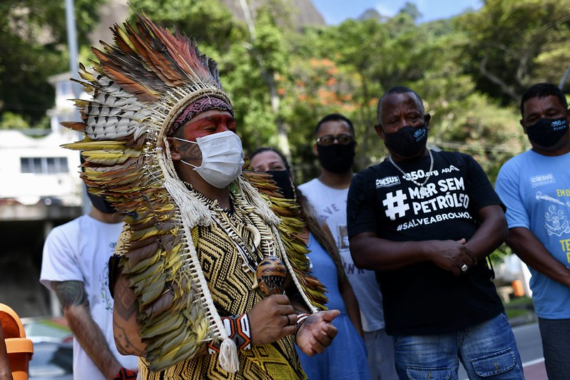 <p>Indigenous leaders protest against the exploitation of their land in Rio de Janeiro, Brazil. Strong land rights can help indigenous communities protect their communal land and sustainably manage forests. Photo by 350.org/Flickr</p>